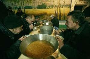 Popova - men eat soup